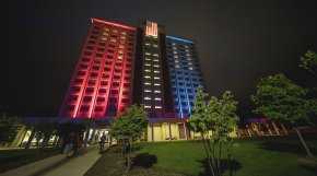Keene Hall illuminated with red and blue lighting