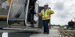 Student Talia Martinez standing on construction machinery
