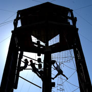 Students climb a tower on the EKU Challenge Course